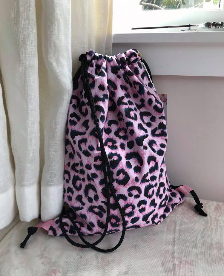 pink leopard with black straps and linen back $35