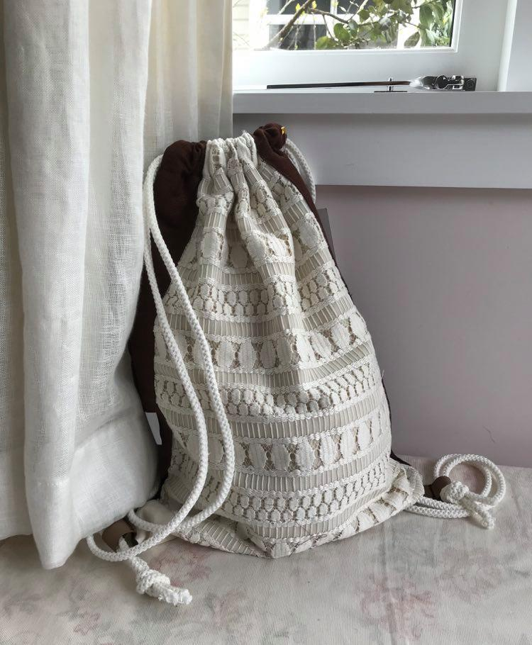 Up -cycled lace with brown linen back $45